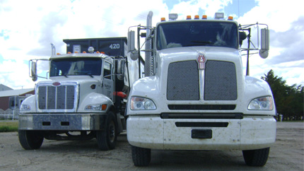 A picture of our roll-off trucks